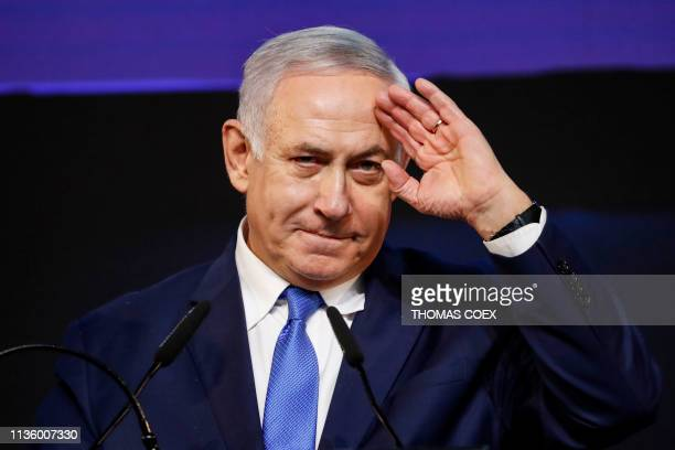 TOPSHOT Israeli Prime Minister Benjamin Netanyahu gestures as he addresses supporters at his Likud Party headquarters in the Israeli coastal city of...