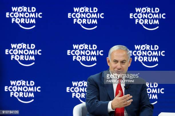 Israeli Prime Minister Benjamin Netanyahu gestures as he attends the World Economic Forum annual meeting on January 25 2018 in Davos eastern...