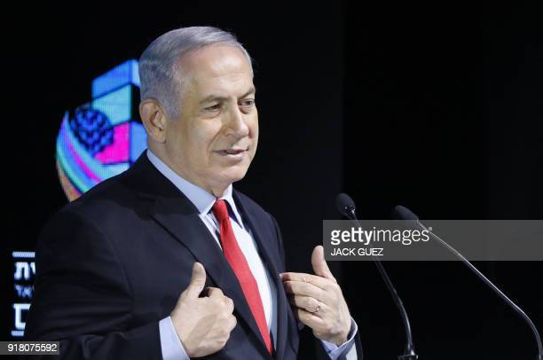 Israeli Prime Minister Benjamin Netanyahu gestures as he attends the Muni World conference in Tel Aviv on February 14 2018 Netanyahu said today his...