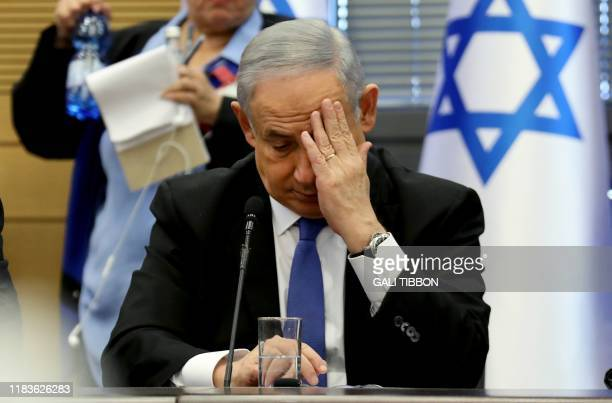 TOPSHOT Israeli Prime Minister Benjamin Netanyahu gestures as he speaks during a meeting of the rightwing bloc at the Knesset in Jerusalem on...