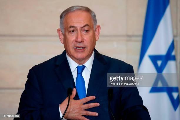 Israeli Prime Minister Benjamin Netanyahu gestures as he speaks during a joint press conference with French President after a meeting at the Elysee...