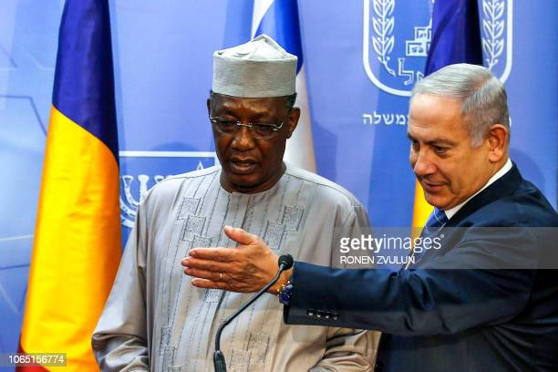 Israeli Prime Minister Benjamin Netanyahu gestures as he stands alongside Chadian President Idriss Deby as they deliver joint statements in Jerusalem...