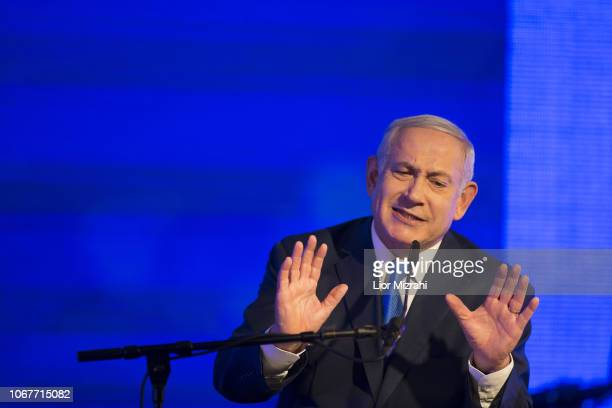 Israeli Prime Minister Benjamin Netanyahu gestures while delivering a speech before lighting a stylisedmenorah during the start of Hanukkah the...