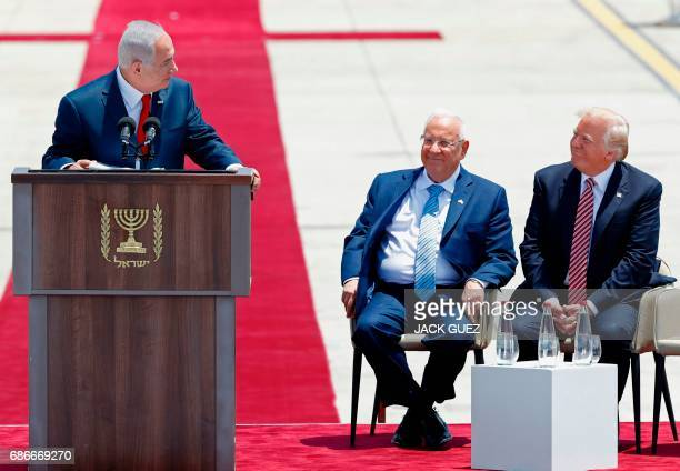 TOPSHOT Israeli Prime Minister Benjamin Netanyahu gives a speech as US President Donald Trump and Israeli President Reuven Rivlin listen on during a...
