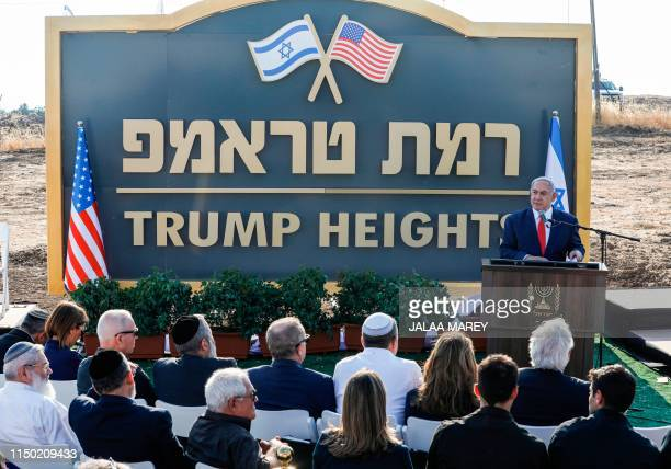 Israeli Prime Minister Benjamin Netanyahu gives a speech before the newlyunveiled sign for the new settlement of Ramat Trump or Trump Heights in...