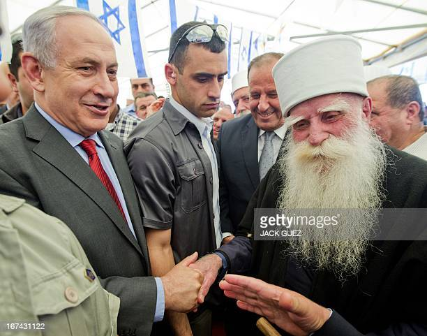 Israeli Prime Minister Benjamin Netanyahu greets a member of the Druze community during the occasion of the Nabi Shoaib holiday on April 25 2013 in...