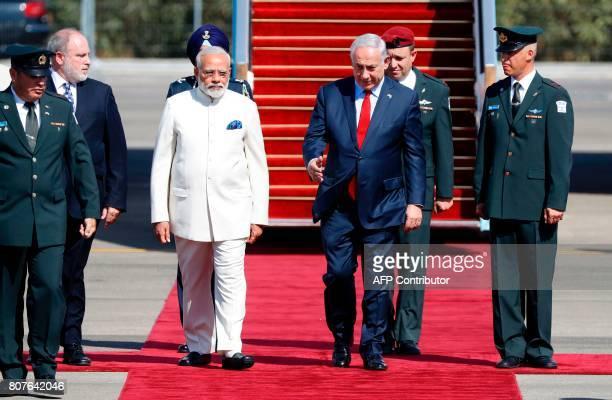 Israeli Prime Minister Benjamin Netanyahu greets his Indian counterpart Narendra Modi during an official ceremoney at BenGurion International airport...