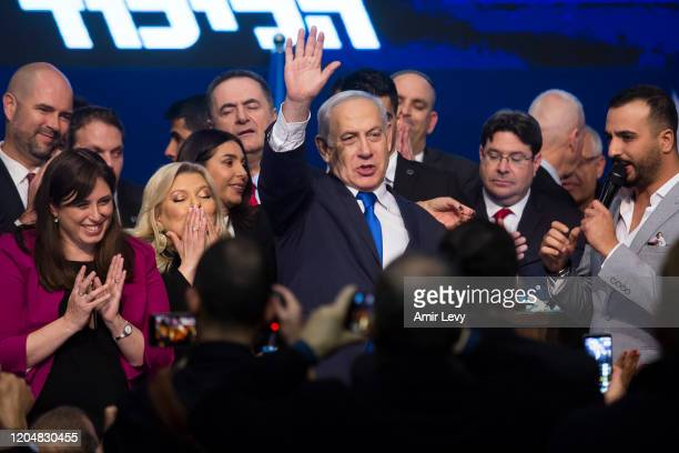 Israeli Prime Minister Benjamin Netanyahu greets Likud Party supporters at the Party's after vote celebration on March 3 2020 in Tel Aviv Israel...