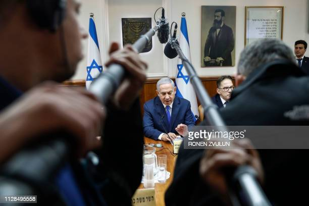 TOPSHOT Israeli Prime Minister Benjamin Netanyahu heads the weekly cabinet meeting in Jerusalem March 3 2019