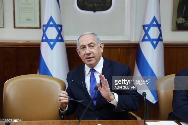 Israeli Prime Minister Benjamin Netanyahu heads the weekly cabinet meeting at the Prime Minister's office in Jerusalem, on December 29, 2019.