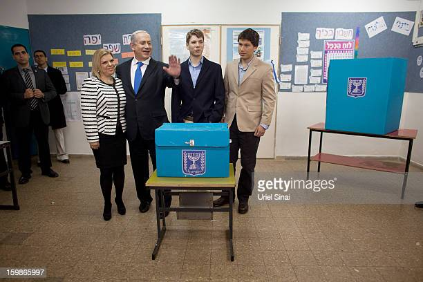 Israeli Prime Minister Benjamin Netanyahu, his wife Sara Netanyahu and sons Yair Netanyahu and Avner Netanyahu pose for a photograph after castsing...