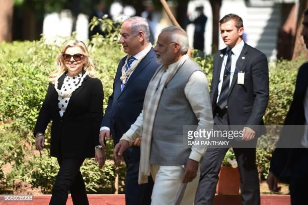 Israeli Prime Minister Benjamin Netanyahu his wife Sara Netanyahu and Indian Prime Minister Narendra Modi talk during a visit to the Gandhi Ashram in...