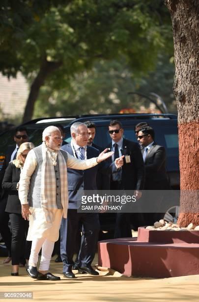 Israeli Prime Minister Benjamin Netanyahu his wife Sara Netanyahu and Indian Prime Minister Narendra Modi walk through the Gandhi Ashram in Ahmedabad...