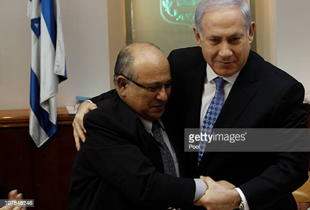 Israeli Prime Minister Benjamin Netanyahu hugs outgoing director of Israel's spy agency Mossad, Meir Dagan during a cabinet meeting on January 2,...