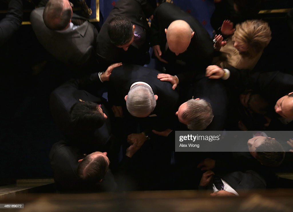 Israeli Prime Minister Benjamin Netanyahu (C) is surrounded by members as he leaves the House Chamber after speaking about Iran to a joint meeting of the United States Congress at the U.S. Capitol March 3, 2015 in Washington, DC. At the risk of further straining the relationship between Israel and the Obama Administration, Netanyahu warned members of Congress against what he considers an ill-advised nuclear deal with Iran.