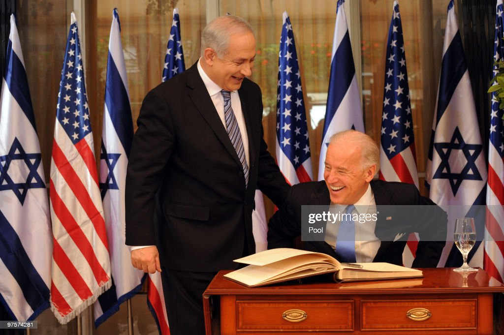 Israeli Prime Minister Benjamin Netanyahu laughs with US Vice President Joe Biden after he signed the guestbook at the Prime Minister's residence on March 9, 2010 in Jerusalem, Israel. The American Vice-President is in the Middel East to meet Israeli leaders including Peres and Israeli Prime Minister Benjamin Netanyahu before travelling to Jordan on Thursday.