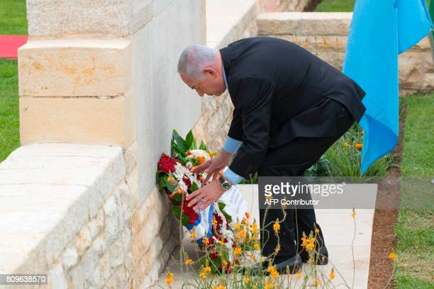 Israeli Prime Minister Benjamin Netanyahu lays a wreath during a memorial ceremony at the Indian Army Cemetery of the World War I to honour fallen...