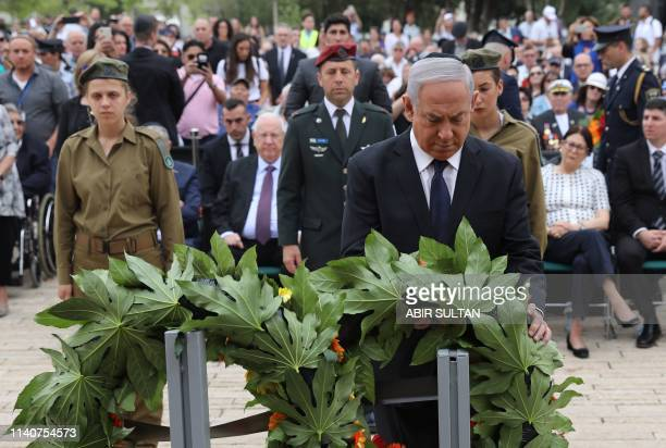 Israeli Prime Minister Benjamin Netanyahu lays a wreath during a ceremony marking the annual Holocaust Remembrance Day at Yad Vashem Holocaust...