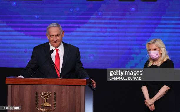 Israeli Prime Minister Benjamin Netanyahu, leader of the Likud party, appears with his wife Sara to address supporters at the party campaign...
