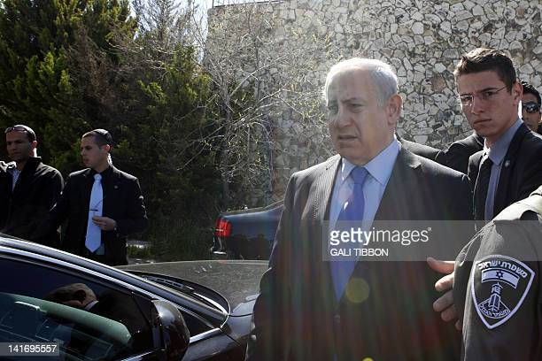 Israeli Prime Minister Benjamin Netanyahu leaves after offering his condolences to the Sandler family in Jerusalem on March 22 following the Toulouse...