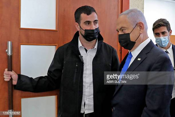 Israeli Prime Minister Benjamin Netanyahu leaves the courtroom at district court in Jerusalem on April 5 during his corruption trial.