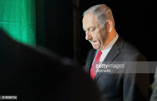 TOPSHOT Israeli Prime Minister Benjamin Netanyahu leaves the Muni World conference in Tel Aviv on February 14 2018 Netanyahu said today his...