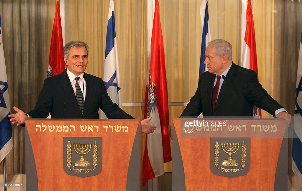 Israeli Prime Minister Benjamin Netanyahu (R) listens as Austrian Chancellor Werner Faymann speaks during a joint statement to the press at Netanyahu's residence June 23, 2010 in Jerusalem, Israel. Faymann is the first foreign leader to meet with Prime Minister Benjamin Netanyahu since the Gaza flotilla raid in May.