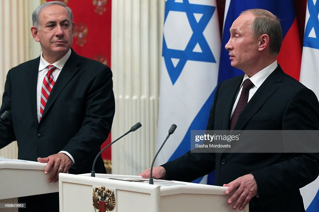 Israeli Prime Minister Benjamin Netanyahu (L) listens as Russian President Vladimir Putin speaks during a meeting in the Kremlin on November 20, 2013 Moscow, Russia. Netanyahu made a one-day visit to Russia to press Putin on a deal concerning Iran's nuclear activities.