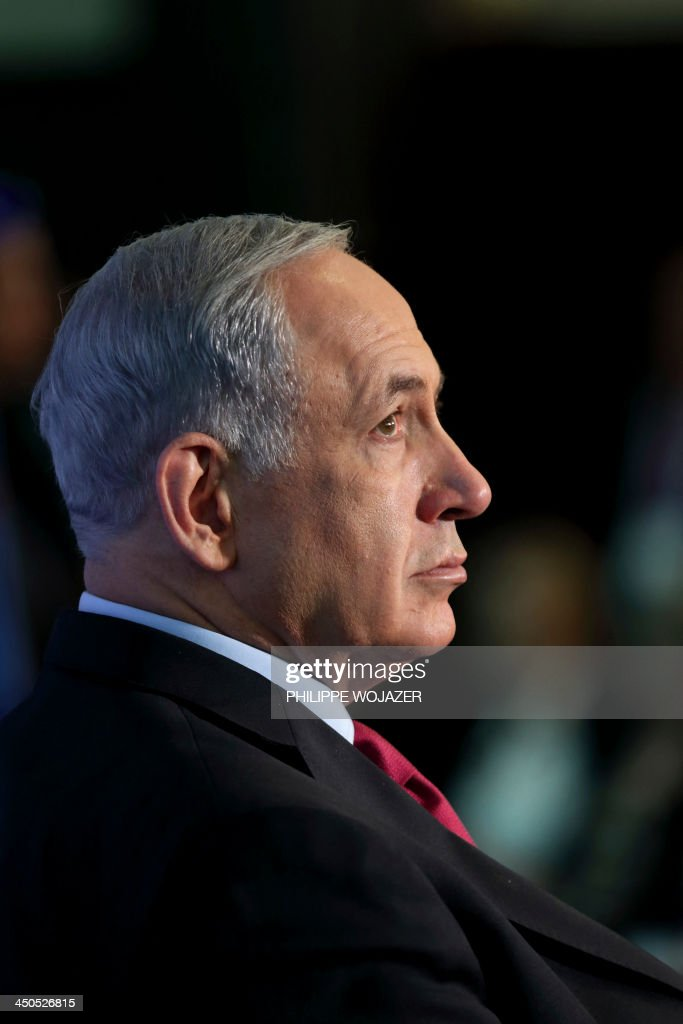Israeli Prime Minister Benjamin Netanyahu listens to a speech during their visit to the second edition of the Israel-France innovation day in Tel Aviv on November 19, 2013 as French President Francois Hollande wrapped up a three-day trip to Israel and the Palestinian territories by attending the technology event and meeting French community members.