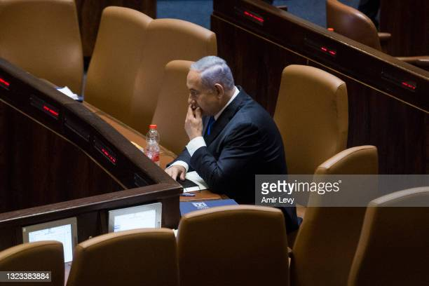 Israeli Prime Minister Benjamin Netanyahu look thoughtful as he sits in the Knesset before parliament votes to approve the new government on June 13,...