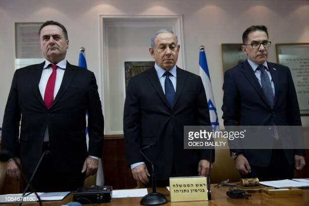 Israeli Prime Minister Benjamin Netanyahu Minister of Transport Yisrael Katz and Cabinet Secretary Tzachi Braverman stand for a moment of silence for...
