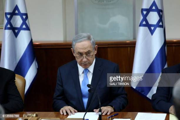 Israeli Prime Minister Benjamin Netanyahu opens the weekly cabinet meeting at his Jerusalem office moments after he was informed about a shooting...