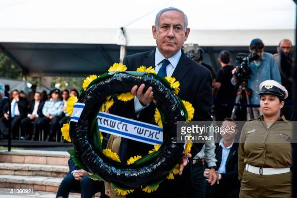 Israeli Prime Minister Benjamin Netanyahu places a wrath on the grave of former Israeli prime minister Yitzhak Rabin during a state memorial ceremony...