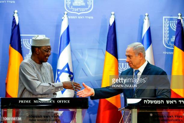 Israeli Prime Minister Benjamin Netanyahu prepares to shake hands with Chadian President Idriss Deby as they deliver joint statements in Jerusalem...