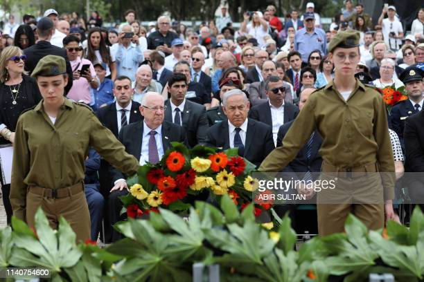 Israeli Prime Minister Benjamin Netanyahu President Reuven Rivlin attend a ceremony marking the annual Holocaust Remembrance Day at Yad Vashem...