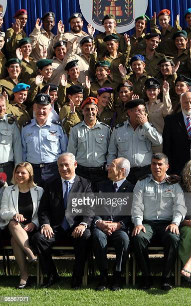 Israeli Prime Minister Benjamin Netanyahu, President Shimon Peres and IDF Chief of Staff Gabi Ashkenazi participate at a ceremony for outstanding...