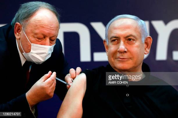 Israeli Prime Minister Benjamin Netanyahu receives a coronavirus vaccine at the Sheba Medical Center, the country's largest hospital, in Ramat Gan...