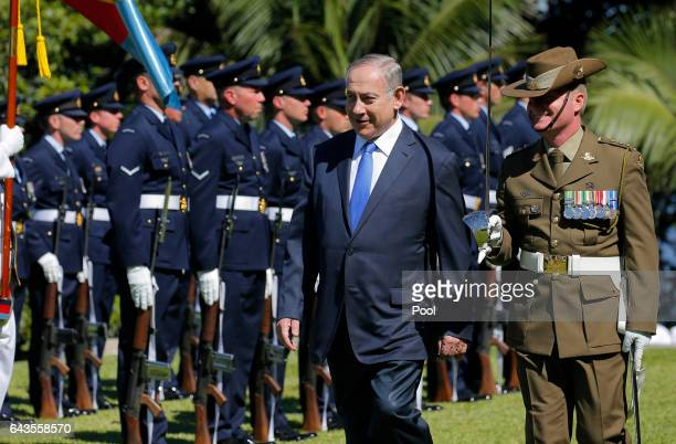 Israeli Prime Minister Benjamin Netanyahu reviews an Australian Military honour guard at Admiralty House on February 22 2017 in Sydney Australia...