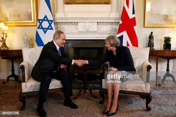 Israeli Prime Minister Benjamin Netanyahu shakes hands with British Prime Minister Theresa May at 10 Downing Street on February 6, 2017 in London,...