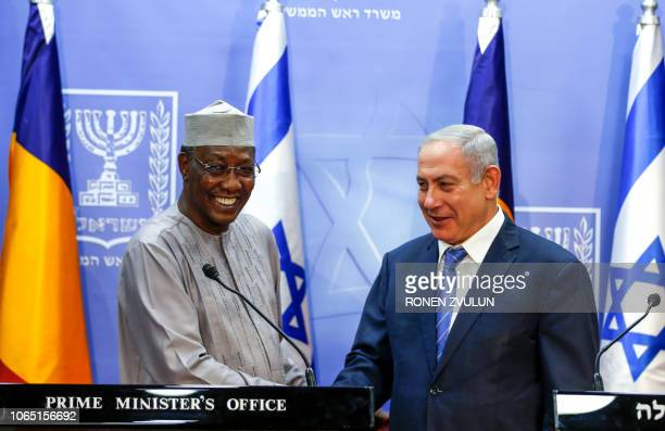 Israeli Prime Minister Benjamin Netanyahu shakes hands with Chadian President Idriss Deby as they deliver joint statements in Jerusalem November 25...