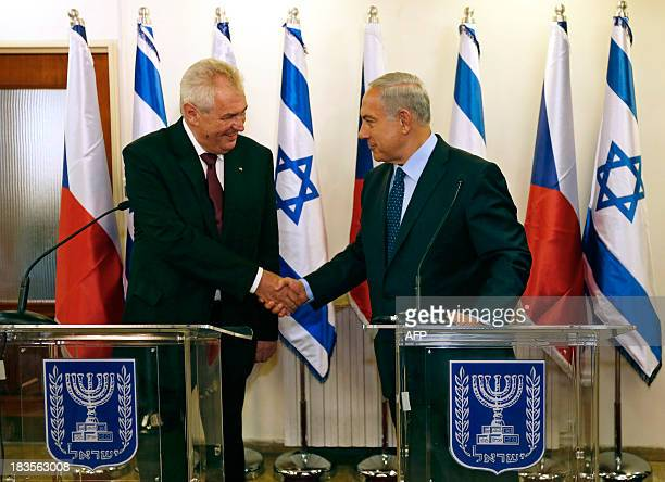 Israeli Prime Minister Benjamin Netanyahu shakes hands with Czech President Milos Zeman as they deliver joint statements in Jerusalem on October 7,...