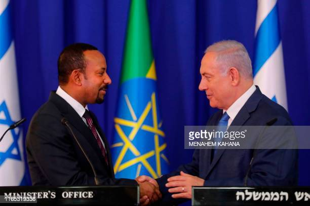 Israeli Prime Minister Benjamin Netanyahu shakes hands with his Ethiopian counterpart Abiy Ahmed during a joint press conference at the prime...