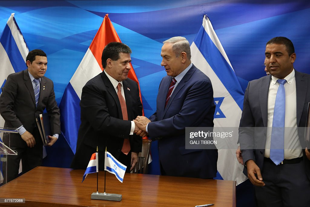 Israeli Prime Minister Benjamin Netanyahu 2r Shakes Hands With