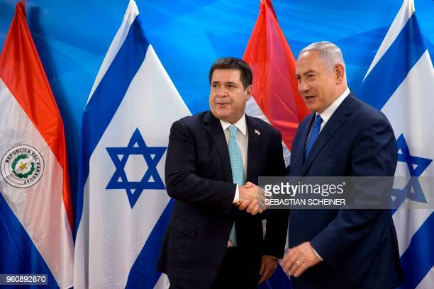 Israeli Prime Minister Benjamin Netanyahu shakes hands with Paraguayan President Horacio Cartes during their meeting at the Prime Minister's office...