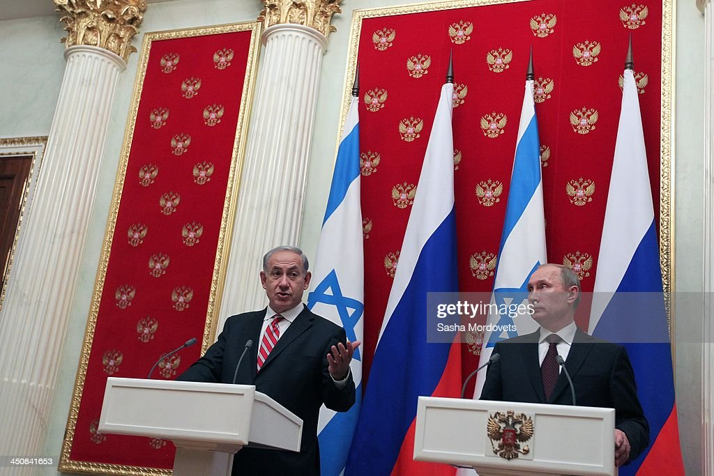 Israeli Prime Minister Benjamin Netanyahu (L) speaks as Russian President Vladimir Putin listens to during a meeting in the Kremlin on November 20, 2013 Moscow, Russia. Netanyahu made a one-day visit to Russia to press Putin on a deal concerning Iran's nuclear activities.