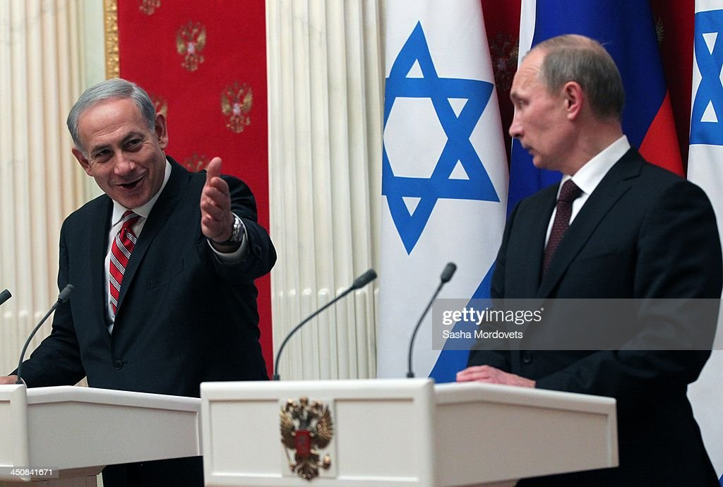 Israeli Prime Minister Benjamin Netanyahu (L) speaks as Russian President Vladimir Putin listens during a meeting in the Kremlin on November 20, 2013 Moscow, Russia. Netanyahu made a one-day visit to Russia to press Putin on a deal concerning Iran's nuclear activities.