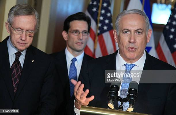 Israeli Prime Minister Benjamin Netanyahu speaks as Senate Majority Leader Harry Reid and US Rep Eric Cantor listen while addressing the media at the...