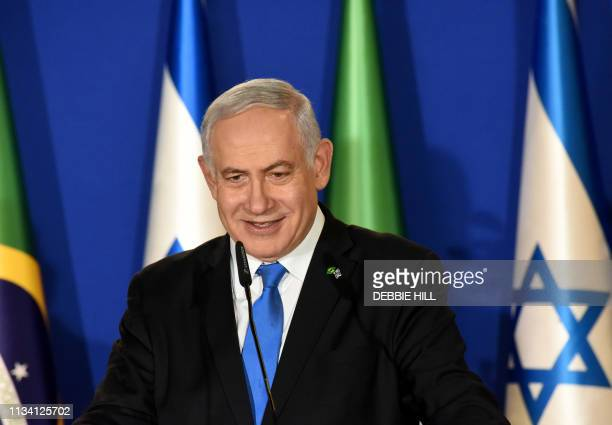 Israeli Prime Minister Benjamin Netanyahu speaks during a joint press conference with the Brazilian president at his residence in Jerusalem on March...