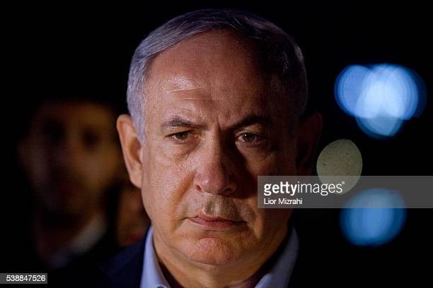 Israeli Prime Minister Benjamin Netanyahu speaks to the press at the scene of a shooting outside Max Brenner restaurant in Sarona Market on June 8...