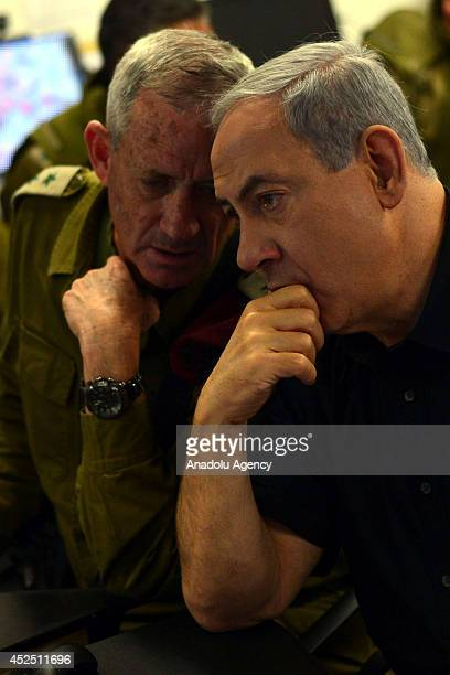Israeli Prime Minister Benjamin Netanyahu speaks with Israel Defense Forces Chief of Staff Benny Gantz during their visit to a tactical headquarters...